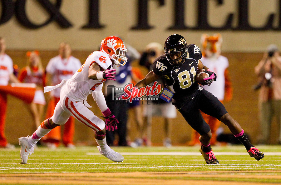 Terence Davis (81) of the Wake Forest Demon Deacons turns up field after making a catch as Garry Peters (26) of the Clemson Tigers closes in to make the tackle at BB&T Field on October 25, 2012 in Winston-Salem, North Carolina.  The Tigers defeated the Demon Deacons 42-13.  (Brian Westerholt/Sports On Film)