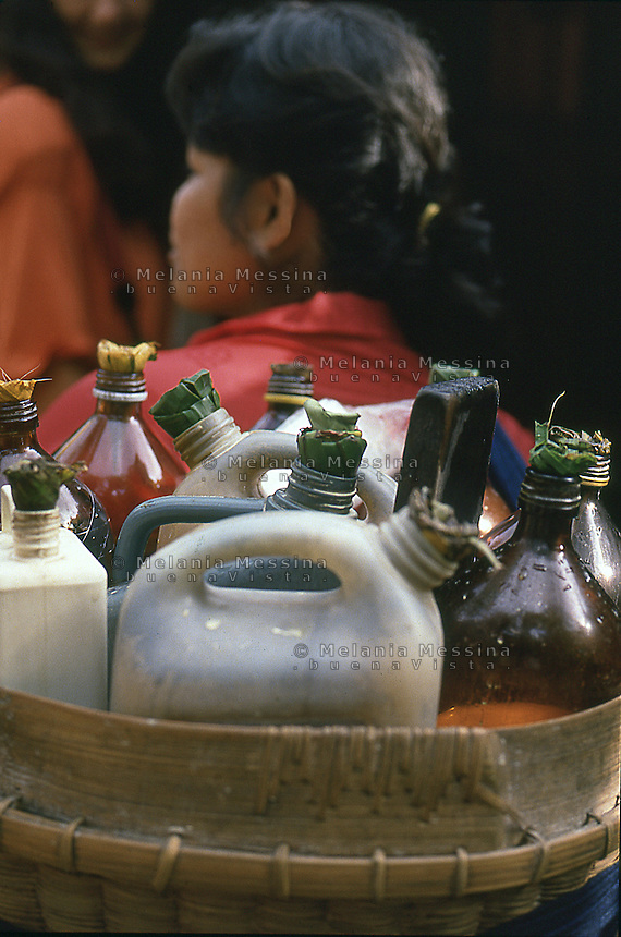 Indonesia, Java island,  bottles of jamu (traditional Javanese herbal medicine).<br />
