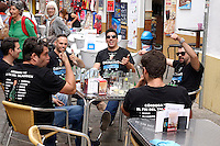 Membes of the Cordoba Spain drinking team hold court at an outside cafe.