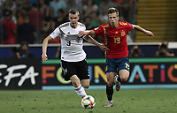 Germany's Lukas Klostermann, left, and Spain's Dani Olmo fight for the ball during the Uefa Under 21 Championship 2019 football final match between Spain and Germany at Udine's Friuli stadium, Italy, June 30, 2019. Spain won 2-1.<br /> UPDATE IMAGES PRESS/Isabella Bonotto