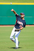 Left fielder Jordan Danks #15 of the United States World Cup/Pan Am Team warms up in the outfield between innings of the game against Team Canada at the USA Baseball National Training Center on September 29, 2011 in Cary, North Carolina.  (Brian Westerholt / Four Seam Images)