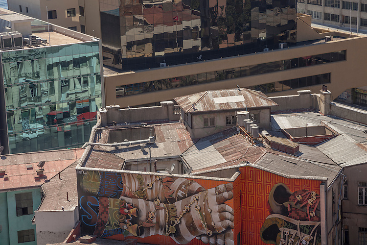 Murals and building reflections spin a visual maze in the port city of Valparaiso, Chile