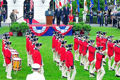 "United States President Barack Obama and President Felipe Calderón of Mexico watch a performance of the ""Old Guard Fife and Drum Corps"" during the state arrival ceremony at the White House for a State Visit on Wednesday, May 19, 2010..Credit: Ron Sachs / CNP"