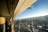 USA, California, San Francisco, man looking out the window of the Airship Ventures Zeppelin, Palo Alto
