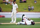 4th December 2017, Basin Reserve, Wellington, New Zealand; International Test Cricket, Day 4, New Zealand versus West Indies;  Trent Boult looks down on injured West Indies batsman Miguel Cummins