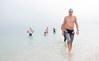 12 MAR 2010 - ABU DHABI, UAE - Rasmus Henning leaves the water after practising on the swim courese the day before the race - Abu Dhabi International Triathlon (PHOTO (C) NIGEL FARROW)