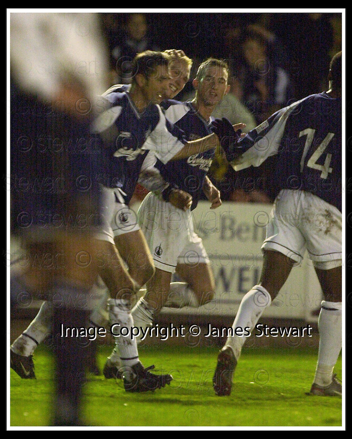 16/11/02       Copyright Pic : James Stewart                     .File Name : stewart-falkirkv ross cty 23.LEE MILLER (CENTRE) IS CONGRATULATED BY OWEN COYLE AND MARK KERR AFTER SCORING THE SECOND...James Stewart Photo Agency, 19 Carronlea Drive, Falkirk. FK2 8DN      Vat Reg No. 607 6932 25.Office : +44 (0)1324 570906     .Mobile : + 44 (0)7721 416997.Fax     :  +44 (0)1324 570906.E-mail : jim@jspa.co.uk.If you require further information then contact Jim Stewart on any of the numbers above.........