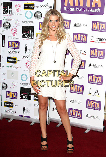 Anna Williamson.Reality TV Awards at the Porchester Hall, London, England..August 30th 2012.full length white dress hand on hip black shoes .CAP/ROS.©Steve Ross/Capital Pictures