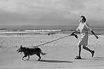 Morning exercising Power Walking the dog, Bondi beach, Sydney Australia.