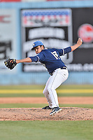 Asheville Tourists pitcher Justin Lawrence (17) delivers a pitch during a game against the Rome Braves at McCormick Field on April 16, 2016 in Asheville, North Carolina. The Braves defeated the Tourists 9-8. (Tony Farlow/Four Seam Images)