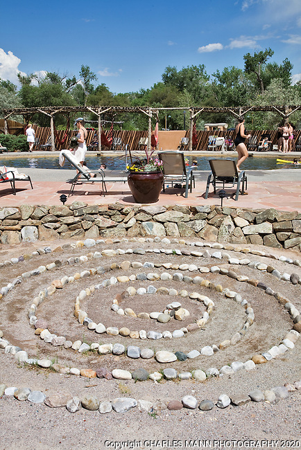 Visitors relax by the big pool at the Ojo Caliente Mineral Springs Resort and Spa near the village of Ojo Caliente