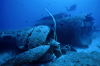 Diver exploring sunken B17 airplane wreck on seabed, France, Corsica island, Calvi