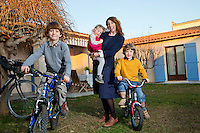Jenny Colgan poses for the photographer with her children Wallace (grey t-shirt), Michael-Francis (yellow jumper) and Delphine at her home in Juan-les-Pins, France 17 January 2012