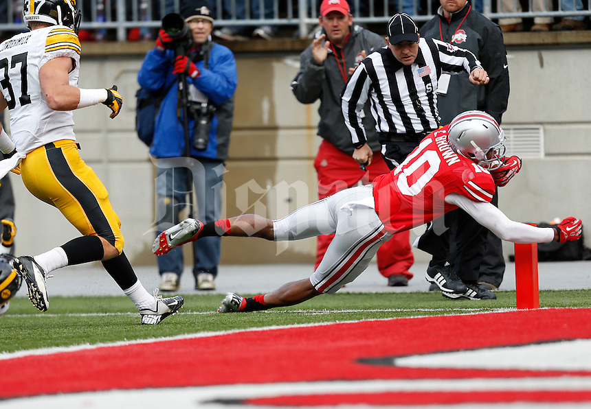 Ohio State Buckeyes wide receiver Philly Brown (10) dives for a touchdown in the second quarter the NCAA football game between the Ohio State Buckeyes and the Iowa Hawkeyes at Ohio Stadium in Columbus, Saturday afternoon, October 19, 2013. As of half time the Iowa Hawkeyes led the Ohio State Buckeyes 17 - 10. (The Columbus Dispatch / Eamon Queeney)