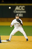 Pat Blair #11 of the Wake Forest Demon Deacons waits for a throw at second base during the game against the North Carolina Tar Heels at Gene Hooks Field on March 11, 2011 in Winston-Salem, North Carolina.  Photo by Brian Westerholt / Four Seam Images