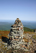 Rock cairn along the Appalachian Trail near the summit of Mount Moosilauke in the White Mountains in the town of Benton, New Hampshire during the summer months.
