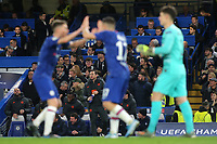 Chelsea Manager, Frank Lampard, calmly gets ready to have a drink while everybody around him celebrates their fourth goal during Chelsea vs AFC Ajax, UEFA Champions League Football at Stamford Bridge on 5th November 2019