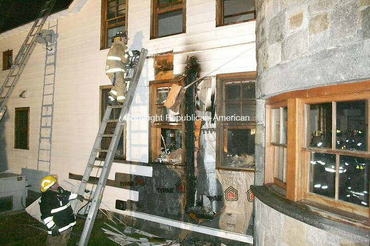 NORFOLK, CT - 29 Nov. 2009 - 112909KM02 - Firefighters work to make sure a fire at 299 Ashpohtag Road in Norfolk does not spread Saturday night. No one was hurt. The cause of the fire at the mansion was still under investigation Sunday. Jonathan Barbagallo Norfolk Fire Department