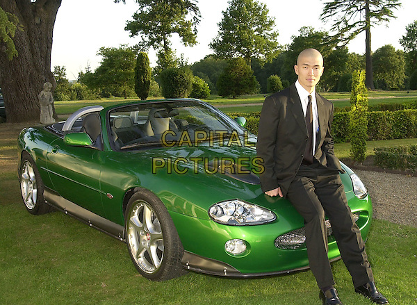 "RICK YUNE .(Zao in ""Die Another Day"").with green 007 car.James Bond Celebrity Golf Classic & Gala Dinner, Stoke Poges, 28th June 2002..full length.Ref: PL.www.capitalpictures.com.sales@capitalpictures.com.©Capital Pictures."