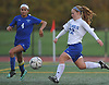Annie Coogan #22 of Calhoun, right, scores a goal in the first half of the Nassau County varsity girls soccer Class AA semifinals against Port Washington at Cold Spring Harbor High School on Monday, Oct. 30, 2017. Calhoun won by a score of 3-0.