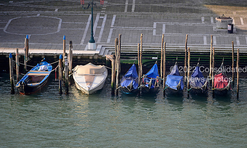 Boats and gondolas parked on the Grand Canal near the Santa Maria della Salute church in the early morning in Venice, Italy on April 15, 2013..Credit: Ron Sachs / CNP