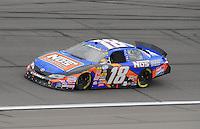 Oct. 3, 2009; Kansas City, KS, USA; NASCAR Nationwide Series driver Kyle Busch (18) during the Kansas Lottery 300 at Kansas Speedway. Mandatory Credit: Mark J. Rebilas-