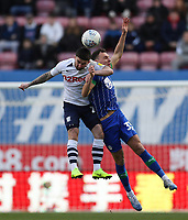 8th February 2020; DW Stadium, Wigan, Greater Manchester, Lancashire, England; English Championship Football, Wigan Athletic versus Preston North End; Darnell Fisher of Preston North End competes for the ball in the air with Kal Naismith of Wigan Athletic