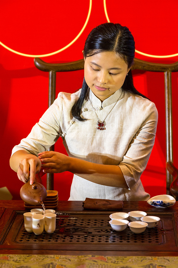Wenzhou, Zhejiang, China.  Young Lady Demonstrating Tea Service.