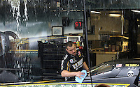 May 11, 2013; Commerce, GA, USA: A crew member for NHRA top fuel dragster driver Tony Schumacher cleans the car during a rain delay to the Southern Nationals at Atlanta Dragway. Mandatory Credit: Mark J. Rebilas-