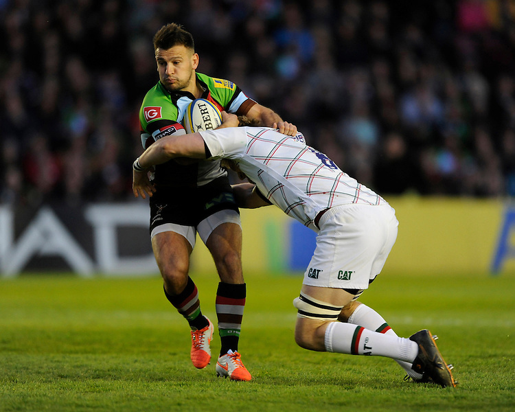 Danny Care of Harlequins is tackled by Jamie Gibson of Leicester Tigers during the Aviva Premiership match between Harlequins and Leicester Tigers at the Twickenham Stoop on Friday 18th April 2014 (Photo by Rob Munro)