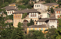 Traditional Ottoman tower house in Gjirokastra, Southern Albania, in the historical region of Epirus, with most Ottoman houses dating from the 17th and 18th centuries. Typical houses consist of a tall stone block structure up to 5 storeys, with external and internal staircases surrounding the house. Gjirokastra was settled by the Greek Chaonians, the Romans and Byzantines before becoming an Ottoman city in 1417. Its old town was listed as a UNESCO World Heritage Site in 2005. Picture by Manuel Cohen