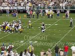 Oakland Raider's Janikowski kicking a FG vs the Pittsburg Steelers.