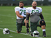 Brian Winters #67 of the New York Jets, right, and #76 Wesley Johnson stretch during the start of a day of team training camp at Atlantic Health Jets Training Center in Florham Park, NJ on Thursday, Aug. 4, 2016.
