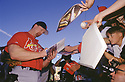 CIRCA 1998: Mark McGwire #25, of the St, Louis Cardinals, signing autographs before a game from his career with the St, Louis Cardinals. Mark McGwire played for 16 years with 2 different teams, was a 13-time All-Star and won the Rookie of the Year in 1987.((Photo by: 1998 SportPics)  *** Local Caption *** Mark McGwire