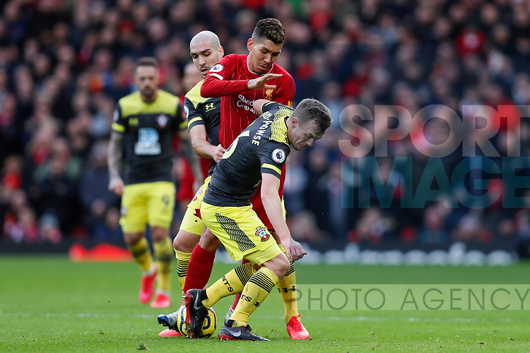Roberto Firmino of Liverpool and James Ward-Prowse of Southampton battle for the ball during the Premier League match at Anfield, Liverpool. Picture date: 1st February 2020. Picture credit should read: James Wilson/Sportimage