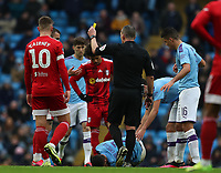 26th January 2020; Etihad Stadium, Manchester, Lancashire, England; English FA Cup Football, Manchester City versus Fulham; Joe Bryan of Fulham is shown a yellow card by referee Kevin Friend for his foul on Joao Cancelo of Manchester City
