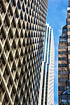 Upward view of buildings and architectural patterns on Market Street in San Francisco.