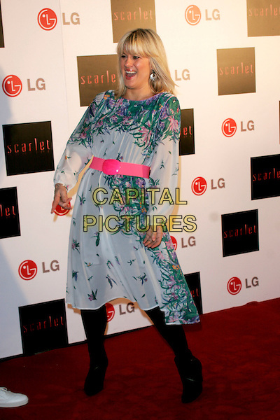 "GEORGINA BOUZOVA.""Scarlet"" - TV series launch, No. 1 Marylebone, Marylebone Road, London, England..April 30th, 2008.full length white green pink floral print pattern dress belt black tights funny .CAP/AH.©Adam Houghton/Capital Pictures."
