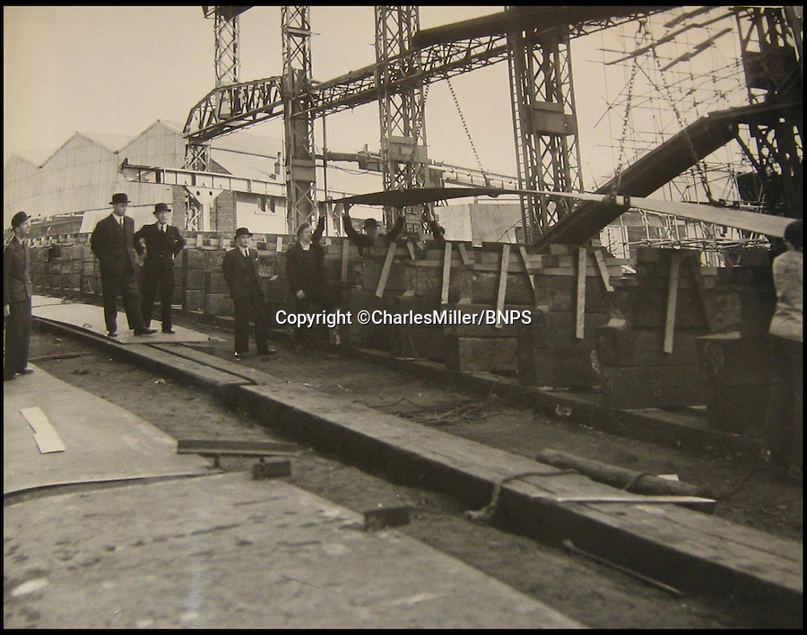 BNPS.co.uk (01202 558833)<br /> Pic: CharlesMiller/BNPS<br /> <br /> ***Must use full byline***<br /> <br /> Laying of the first keel plate. <br /> <br /> Rare photographs showing the complete construction of the much-loved Royal yacht Britannia have surfaced 60 years later.<br /> <br /> The image archive was recorded by shipbuilders John Brown &amp; Co during the 10 months it took to build the 412ft long vessel for Queen Elizabeth II.<br /> <br /> The 70 black and white photos document virtually every stage of the project, from the laying of the keel in June 1952 to the furnishing of state dining room in April 1953.<br /> <br /> They show cloth-capped, blue collar engineers hard at work while management in smart suits and bowler hats carefully inspect the build.<br /> <br /> Some of the shots of the yacht in dry dock show it covered in scaffolding and highlight the two enormous propellers at the stern.