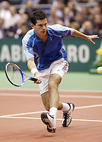 22-2-06, Netherlands, tennis, Rotterdam, ABNAMROWTT, Tim Henman in action against Thomas Johansson