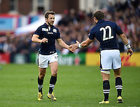 Greig Laidlaw of Scotland high-fives team-mate Pete Horne. Rugby World Cup Pool B match between Scotland and Japan on September 23, 2015 at Kingsholm Stadium in Gloucester, England. Photo by: Patrick Khachfe / Onside Images