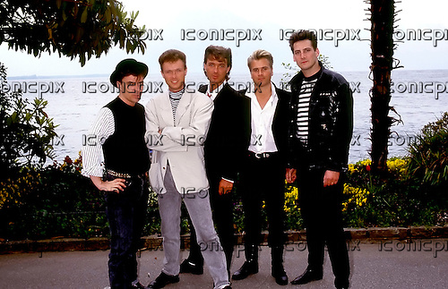 Spandau Ballet - (L-R: John keeble, Gary Kemp, Martin Kemp, Steve Norman, Tony Hadley) - photocall on the shores of Lake Geneva at the Rose d'Or Festival held at Montreux, Switzerland - 13 May 1987.   Photo by: George Chin/IconicPix