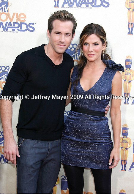 UNIVERSAL CITY, CA. - May 31: Actors Ryan Reynolds and Sandra Bullock arrive at the 2009 MTV Movie Awards held at the Gibson Amphitheatre on May 31, 2009 in Universal City, California.