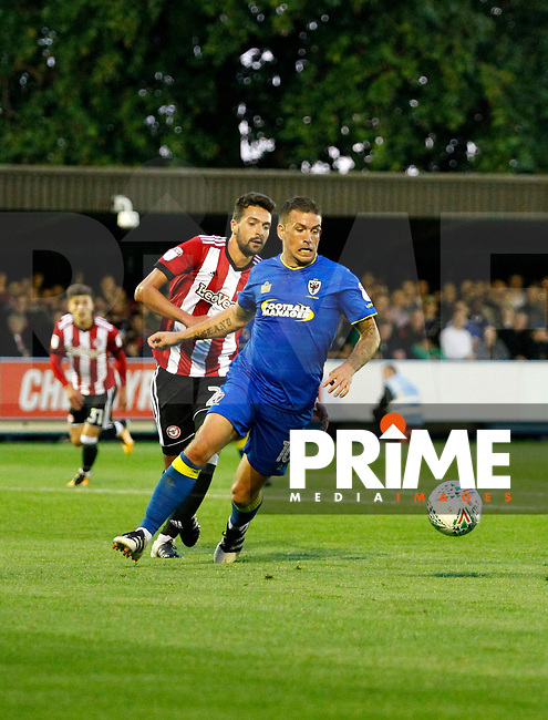 AFC Wimbledon's Cody McDonald on the ball during the Carabao Cup match between AFC Wimbledon and Brentford at the Cherry Red Records Stadium, Kingston, England on 8 August 2017. Photo by Carlton Myrie.