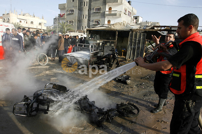 Palestinian Firefighters tries to extinguish a fire after an Israeli airstrike in Rafah, southern Gaza Strip, Saturday, March 10, 2012. The airstrike killed Popular Resistance Committees militant Mahdi Abu Shawesh. Despite Egyptian efforts to mediate a cease-fire, both sides remained defiant with Palestinians firing more than 100 rockets, some striking major cities in southern Israel, and the military responding with the targeted killings of more than 15 militants. Photo by Abed Rahim Khatib