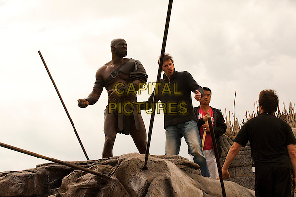 Director Paul W.S. Anderson discusses a scene with Adewale Akinnouye-Agbaje on the set of Pompeii (2014) <br /> *Filmstill - Editorial Use Only*<br /> CAP/FB<br /> Image supplied by Capital Pictures