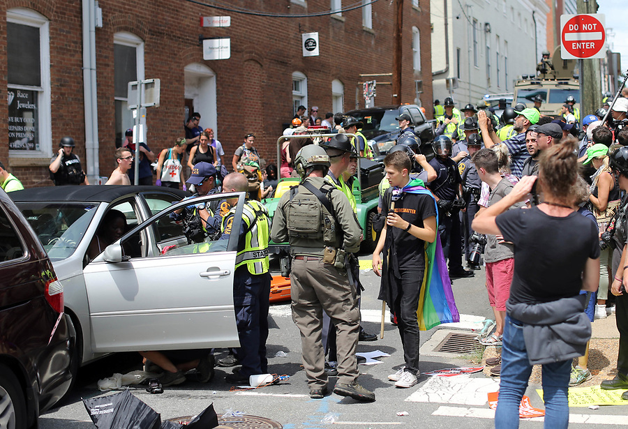 People react after a car driven by Alex Fields, Jr. blow through a crowd of protestors killing 1 and injuring 19 others after the Unite the Right rally Saturday, August 12, 2017 in Charlottesville, Va. Photo/Andrew Shurtleff