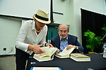 MIAMI, FL - SEPTEMBER 26: Author Salman Rushdie (R) and Vivienne Evans presents and sign copies of His new Book 'Joseph Anton: A Memoir' presented by Books and Books at Chapman Conference Center at Miami Dade College on September 26, 2013 in Miami, Florida. (Photo by Johnny Louis/jlnphotography.com)