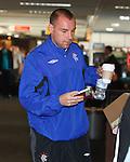 Kris Boyd boards his flight with breakfast in hand