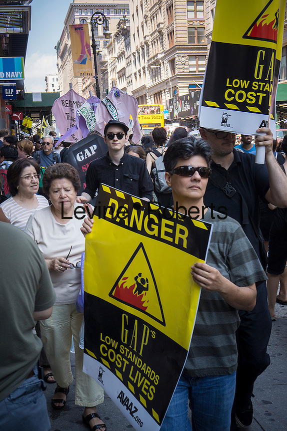 Hundreds of workers and supporters march through the streets of Soho on Saturday, June 29, 2013 stopping off at various clothing retailers protesting the companies' refusal to the Bangladesh Safety Accord guaranteeing better safety conditions in Bangladeshi factories. In April a collapse of an enormous garment factory killed over 1000 workers. (© Richard B. Levine)